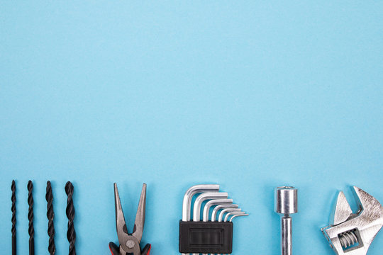 Set of different tools on blue background