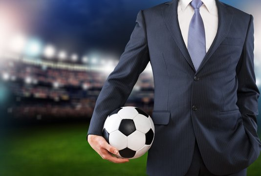 Close-up young male businessman holding Soccer ball