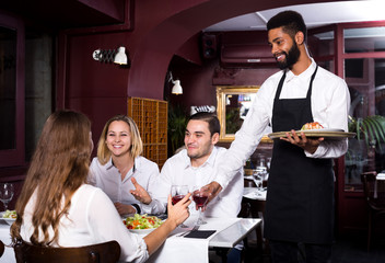 Middle class restaurant and cheerful waiter