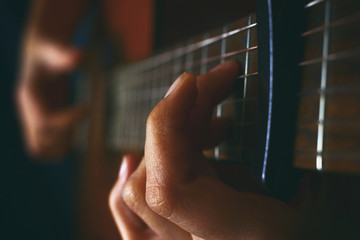 Close up of an acoustic guitar being played