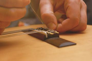 Repairing of broken string on acoustic guitar