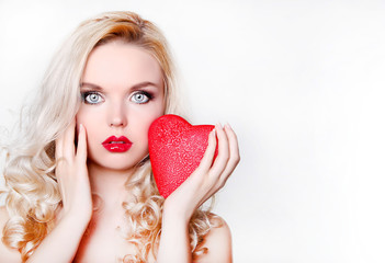Sexy blonde girl with big red heart in love. Valentine Day theme.