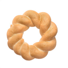Round challah, braided white bread in the form of a ring, isolated on white background.