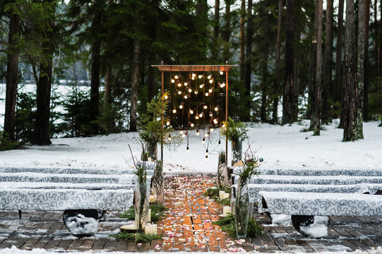 Wedding arch decorated with old light bulbs, winter
