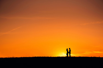 silhouette of a couple in love hugging together