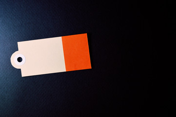 horizontal decorated rectangle paper tag on dark background