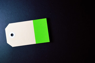 horizontal clipped rectangle paper tag on dark background