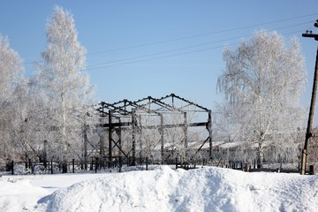 Winter rural landscape in the former Soviet Union. Ruin and beauty at the same time in a rustic winter landscape.