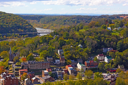 A view on Harpers Ferry National Historic Park and town with railroad station. West Virginia landscape in autumn at the point where Potomac and Shenandoah rivers meet.