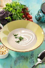 mushroom cream soup on blue wooden table