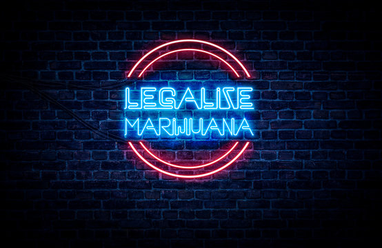 A red and blue neon sign that reads: LEGALIZE MARIJUANA. The sign is on a brick wall background.