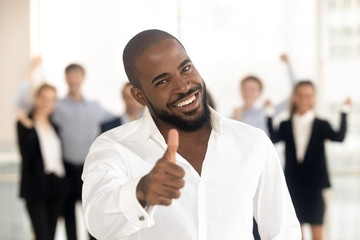 African client showing thumbs up feels satisfied received good service