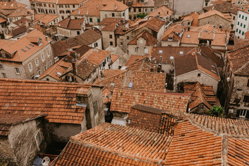 Panoramic aerial view of the red tiled roofs of the old town of Kotor.