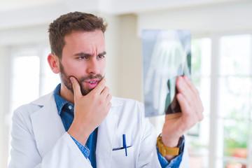 Doctor man looking at x-ray radiography doing body examination