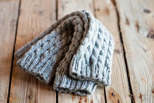 knitted light grey leg warmers