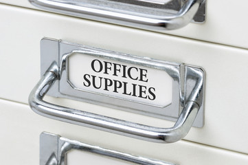 A drawer cabinet with the label Office Supplies