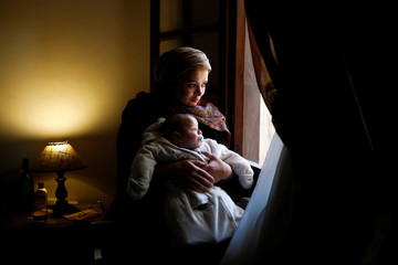 The Wider Image: New mothers suffer nerves, guilt as maternity leave ends