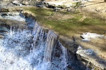 A close view of the waterfall in the creek.