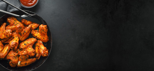 Aluminium Prints Hot chili peppers Chicken wings grilled in sauce on pan