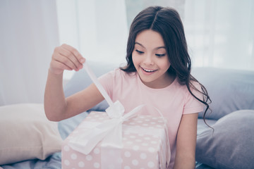 Close up photo sweet emotionally beautiful she her little girl sitting bed hold opening present box best day ever wear home t-shirt pants comfortable apartments flat bright light colored room indoors