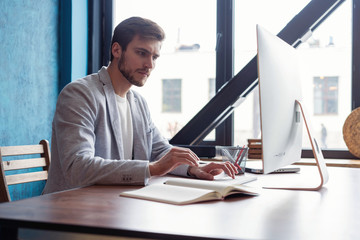 Man Working At Computer In Contemporary Office.