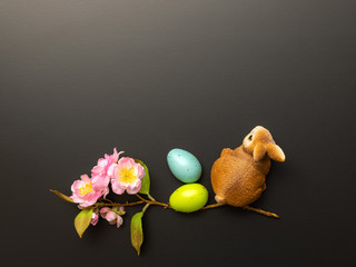 a happy easter decoration with a bunny eggs and blossoms