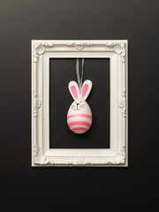 a happy easter decoration with a bunny egg in a frame