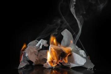 Burning paper on a black background. Ash, fire.