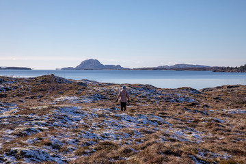 On a hike in coastal landscape at Helgeland in Norway