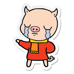 sticker of a cartoon crying pig wearing scarf