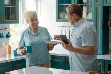 Grandparents talk in the kitchen