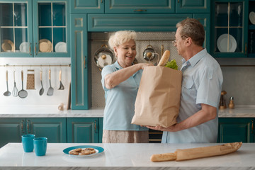 Elderly spouses taking food out