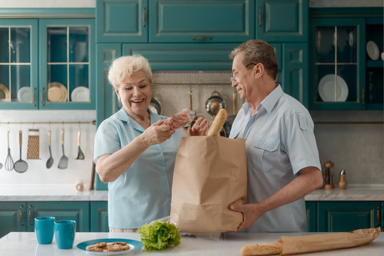 Old couple taking groceries