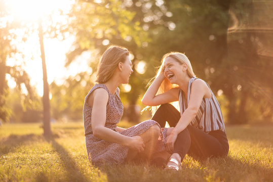 Candid shot of young women sitting in park