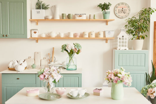 bright kitchen in the style of Provence, on the table dishes and a bouquet of flowers in a vase