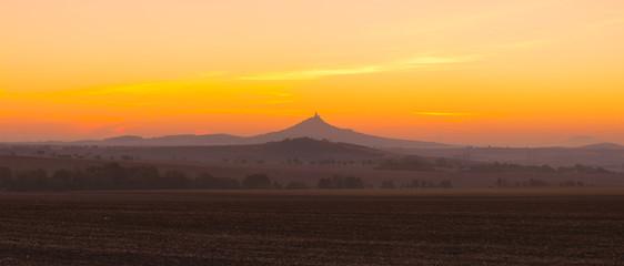 The silhouette of Hazmburk Castle at sunrise.Czech Republic.