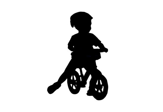 Silhouette Balance Bike for kids. This Boy practicing balance With a bicycle using a plowed leg is a bike without a spinning ladder.