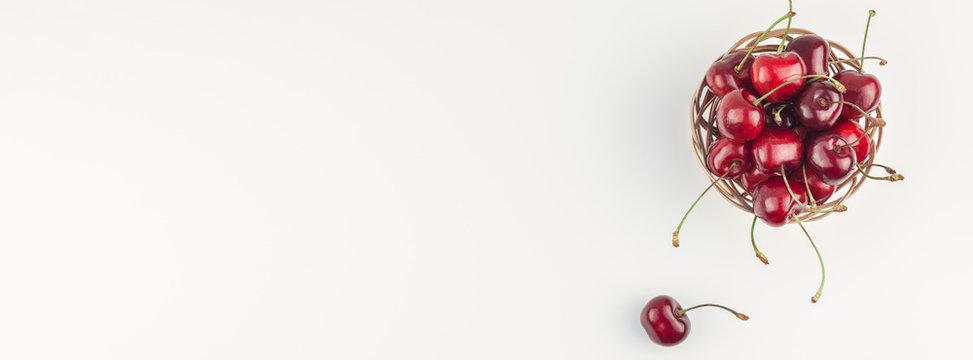 Fresh ripe cherry in a small wicker basket