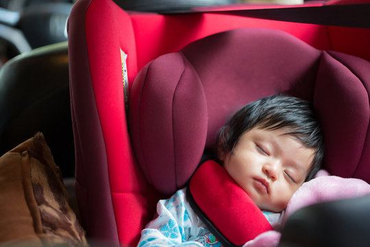 Infant sleeping in child car seat,Safe way to travel fastened seat belts in a vehicle with young kids