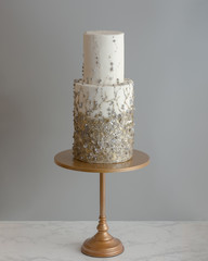 Trendy Tall 2 Tier Wedding Cake With Metallic Texture.