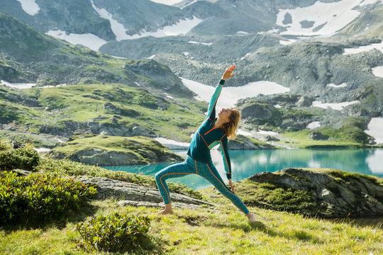 beautiful girl doing yoga in the mountains