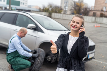 Happy woman with thumb up on car service