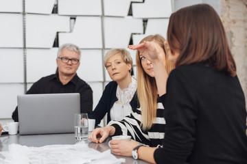 Woman explaining something during a meeting