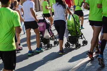 Parents with Pushchairs for Children in a City Marathon Race Event