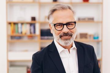 Senior bearded professional man smiling at camera