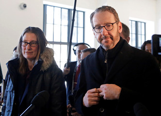 Gerald Butts, who quit last month as Canadian Prime Minister Justin Trudeau's chief aide, leaves after testifying to the House of Commons justice committee with his wife Jodi Butts, in Ottawa