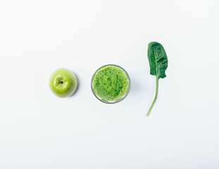 Creative flat lay composition of glass of green smoothie