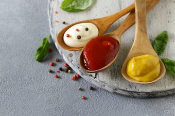 three variants of ketchup, mustard and mayonnaise sauce