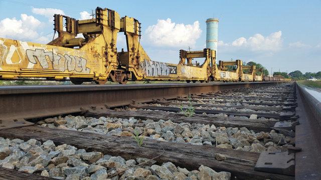 Graffiti on Train Cars on Tracks