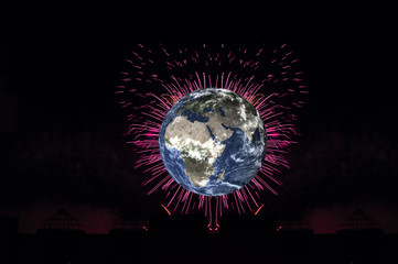 Planet earth with pink heart firework on black background. Planet Earth day concept. Elements of this image were furnished by NASA